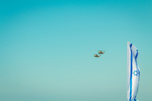 Low Angle View Of Israeli Flag Against Helicopter Flying In Clear Blue Sky