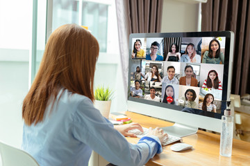 Rear view asian group business people working remotely video conference