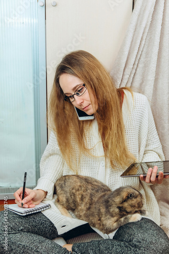 The girl is forced to work at home because of the epidemic of coronavirus Canvas Print