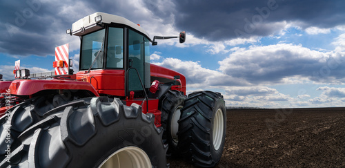 Aufkleber - Back view of tractor on a agricultural field