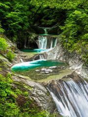 Fototapeta Wodospad Beautiful blue waterfall in deep mountain