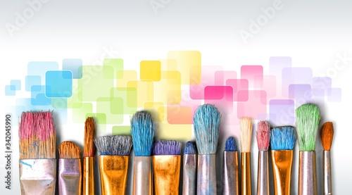 Obraz A row of artist paint brushes on desk - fototapety do salonu