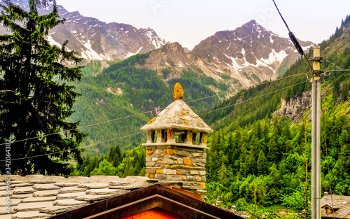 Traditional slate roofs in Aosta Valley Italy Canvas Print