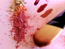Close-up Of Make-up Brush And Blush On Table