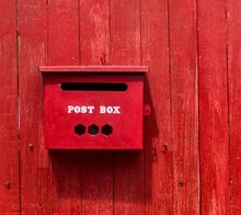 Red Post Box On Wooden Wall