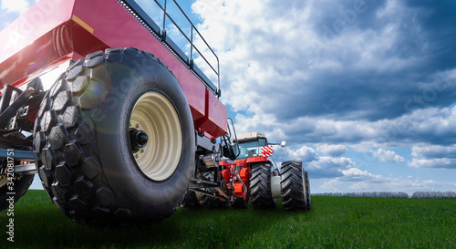 Aufkleber - Back view of modern tractor with cart on a agricultural field
