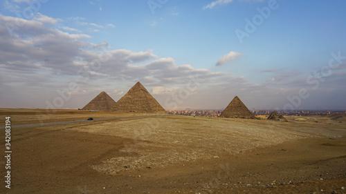 Pyramids of Giza with Giza city view background #342083194