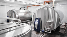 Automated Cow Farm, Milk Tanks. Milking Machine, Modern Production Technology At The Factory