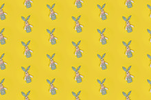 Seamless Colorful Happy Easter Pattern With Cute Rabbits On Bright Yellow Background