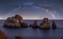 Big Rough Cliffs On Blue Calm ...