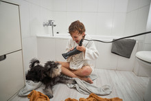 Child Drying His Dog After Sho...