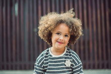 Adorable Little Girl With Curl...