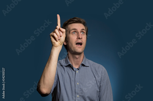 Photo Man Pointing Upwards with Mouth Agape