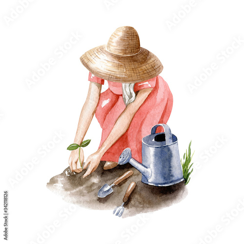 Young blonde woman in straw hat works in garden Fototapeta