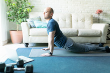 Active Man Doing Yoga At Home