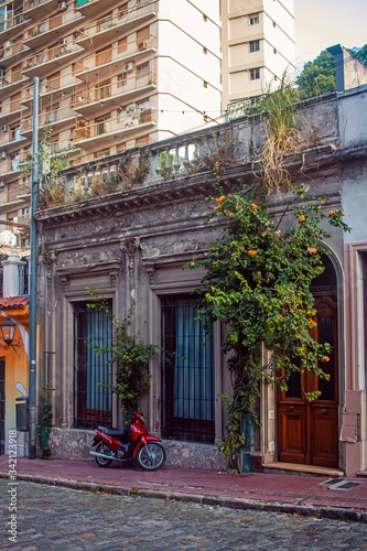 Motorcycle in front of old building Canvas Print