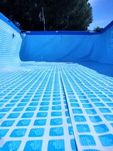 Empty Swimming Pool Against Trees During Sunny Day