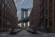 View Of City Street Against Manhattan Bridge