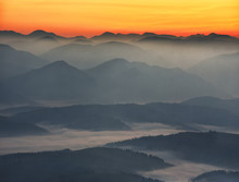 Silhouettes Of Foggy Mountains...