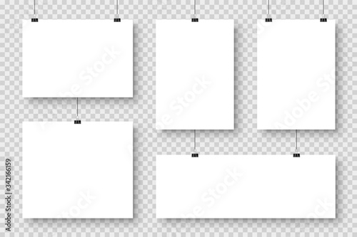 Obraz Realistic blank paper sheets hanging on binder clip. White poster with shadow in A4 format. Design template, mockup. Vector illustration. - fototapety do salonu