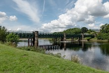 Train Girder Bridge Across River Lochy Near Inverlochy Castle In Nice Sunny Summer Weather With Blue Sky And Clouds