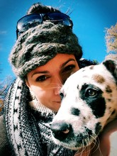 Close-up Portrait Of Woman With Dalmatian Against Clear Blue Sky During Sunny Day