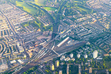 Aerial High Angle View From Airplane Over City Of London In United Kingdom With Clapham Junction Train Station And Railroad Railway Tracks With Depot Storage Warehouse Buildings