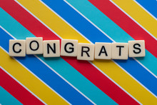 Congrats Letter Tiles On Colorful Background