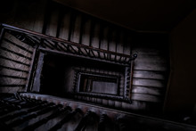 High Angle Above View Down Of Old Vintage Staircase Winding Spiral In Lviv, Ukraine, Europe With Nobody Architecture Dark Low-key Abstract Pattern