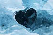 High Angle View Of Heart Shape On Ice During Winter