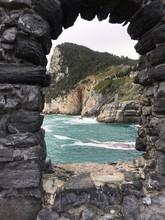 Sea And Mountains Seen Through Stone Window