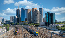 Trains Taveling In And Out Of The City Of Melbourne, Australia.