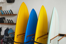 Surf Shop. Set Of Surfboards Standing In Stack At Rental Place On Beach. Water Sport Equipment, Healthy Lifestyle At Tropical Ocean.