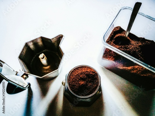 Fotografie, Obraz High Angle View Of Ground Coffee With Maker On Table