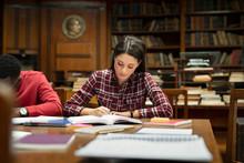 Female Student Studying At Lib...