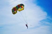 Low Angle View Of Man Parasail...
