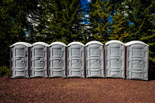 Outhouses In A Row, Outdoors.