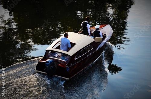 Fotografía People Sailing Motorboat In River