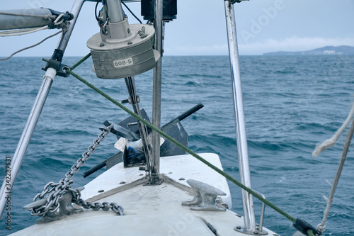 Photo Bow of the sail boat with anchor and anchor chain