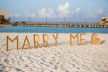 Marry Me Message At Sandy Beach Against Sky