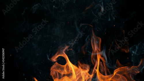 Closeup of fire on black background Wallpaper Mural