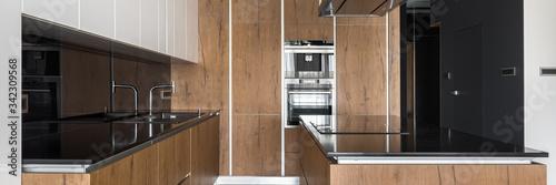 Fototapeta Stylish kitchen with wooden furniture, panorama obraz