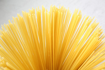 Fototapeta Do baru  Yellow italian pasta. Long spaghetti. Raw spaghetti bolognese. Spaghetti like background.