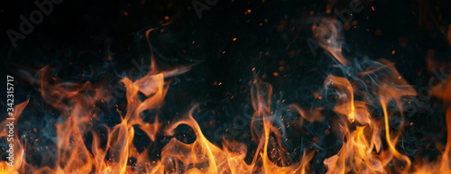Closeup of fire on black background Canvas Print