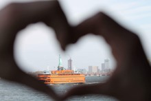 Statue Of Liberty Through Heart Shape Formed By Hands