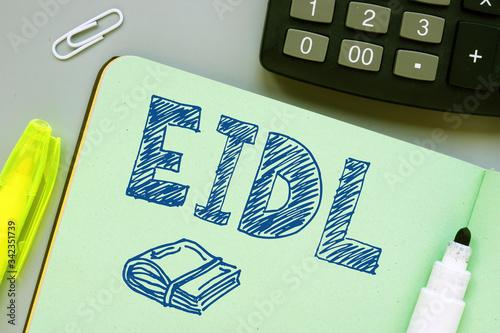 Photo Handwritten acronyms EIDL as The Economic Injury Disaster Loan Program