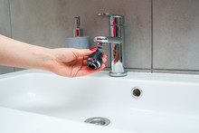 Rotary Nozzle On The Mixer To Adjust The Flow Of Water. White Bathroom Sink For Washing Hands