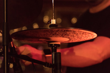 Fototapeta na wymiar Midsection Of Drummer By Cymbal During Music Concert