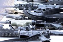 High Angle View Of Guns On Table