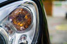 Close-up Of Headlights Of Car